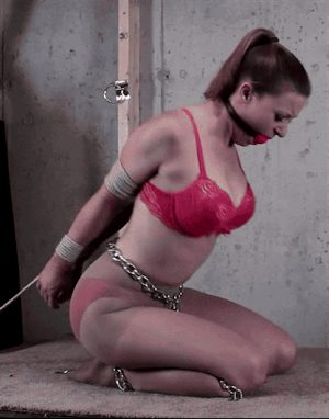 bound ballgagged milf is chained to the floor