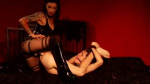 bound slave with ball gag is deeply strapon fucked by dominatrix