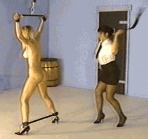 femdom mistress violently whips her slave's ass