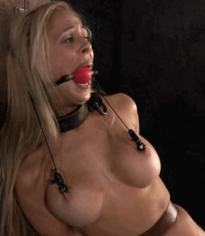 hot blonde bitch with nipple clamps and nipple chain is painfully gagged with a ball gag
