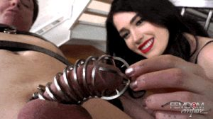 leather mistress dominates bound slave in chastity cage