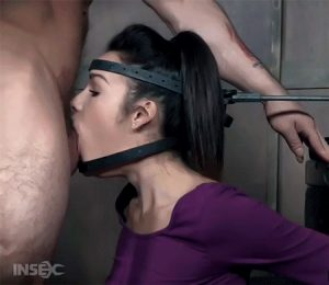 Woman tied and strapped to a machine, training her to become a blowjob giving toy made to deepthroat cocks